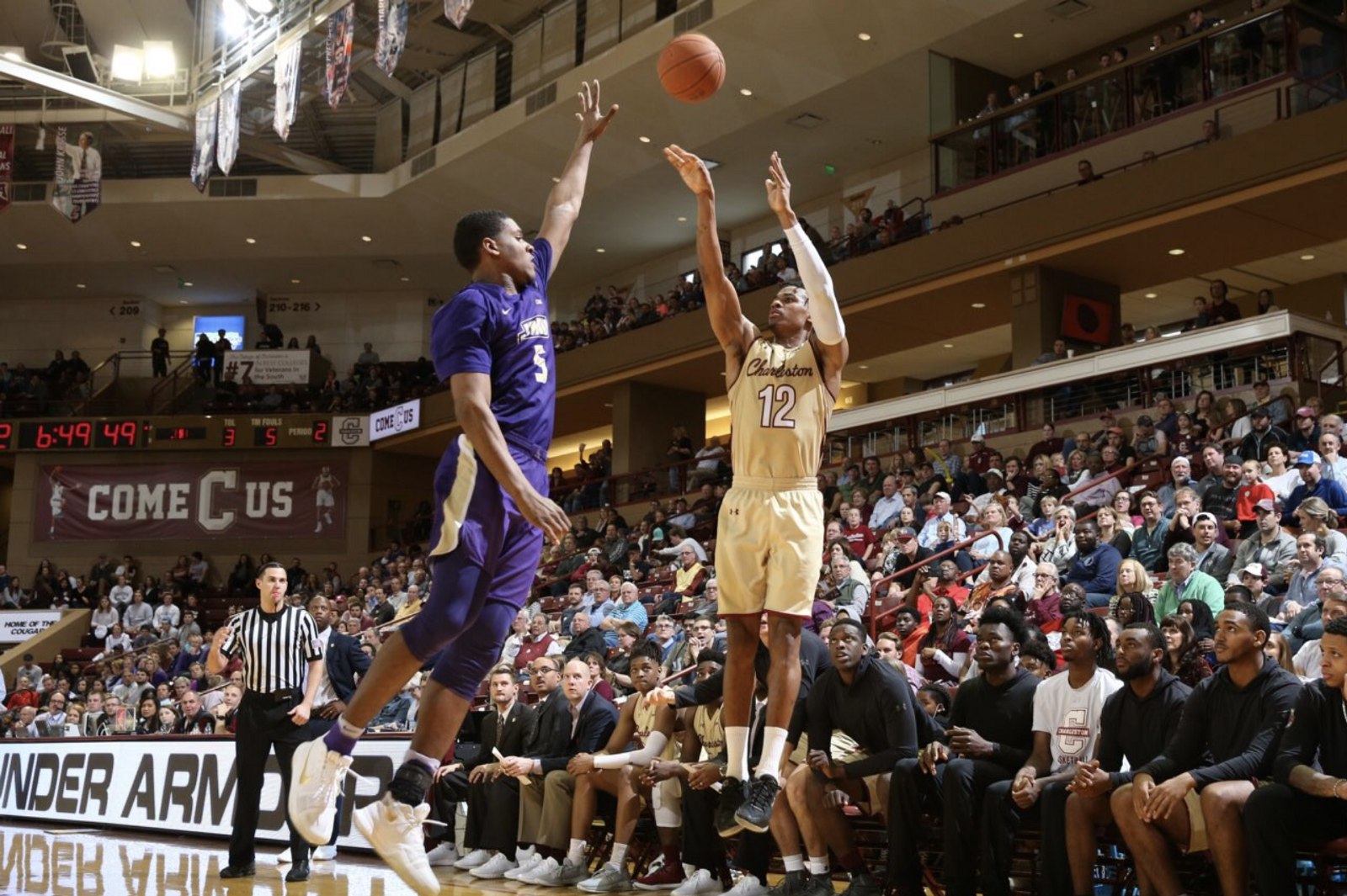 CofC basketball guard Cam Johnson shoots against James Madison University at TD Arena